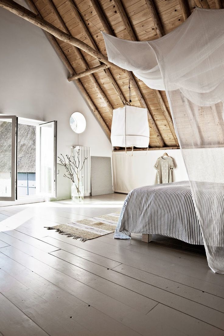 A natural bedroom in a reconstructed barn