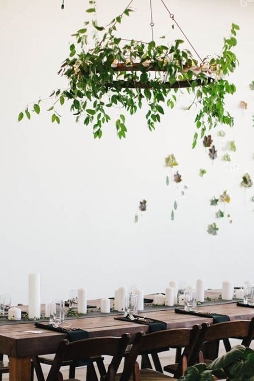 green-chandelier-and-leaves-on-the-wall